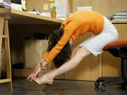 Woman Stretching At Desk