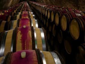 Burgundy Wine Behind The Bottle