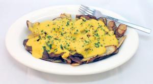 Fried Potato Skins And Vegan Cheese Sauce