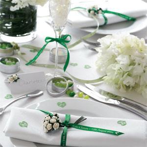 A wedding table setting with green color theme.