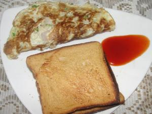 Onion Omelette With Bread And Tomato Ketchup