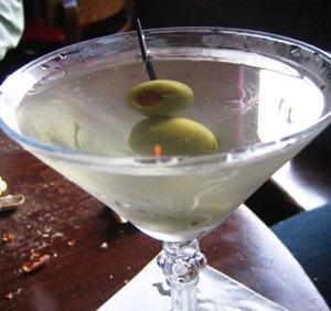 Pickled olive garnish for olive martini.