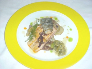 Pan Seared Salmon With Pommes Lyonnaise And Braised Leeks