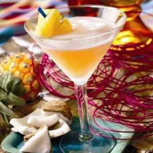 Pineapple rum martini garnished with a pineapple wedge.