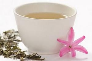 Drink two to three cups of white tea daily for acne treatment