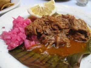 Cochinita Pibil is a Mexican slow-roasted pork dish from the Yucatán Península.