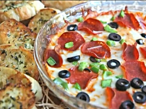 Hot Pizza Dip with Toasted Garlic Baguettes