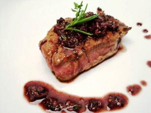 Steak with Rosemary-Thyme Cabernet Peppercorn Sauce