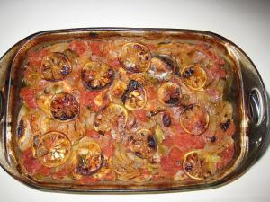 Baked fish with tomatoes and onions. ( Riba Plakia)