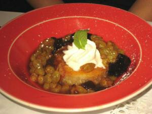 Babas Au Rhum And Savarin With Fruit And Cream