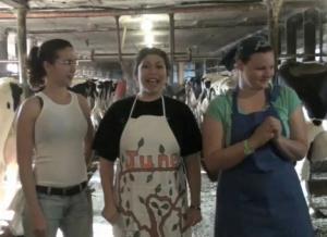 June, the Homemaker, milks a cow