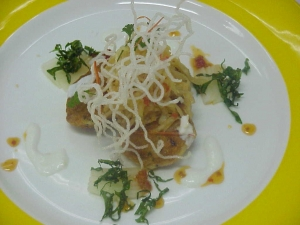 Thai fish cakes with som tam and fried spinach and glass noodles