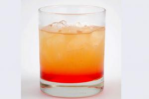 Dragon Slayer Cocktail with a Mix of Orange and Grenadine