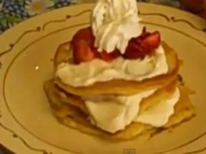 Buttermilk Pancakes with Sweet Cream Filling Topped with Strawberries