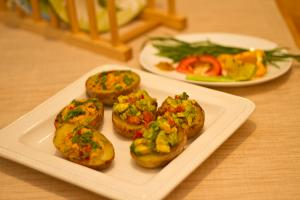 Potato Skins with Avocado Filling and Garlic Mashed Potato