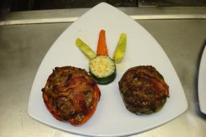 pepper stuffed with beef topped with bacon..