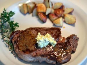 Grilled Ribeye Steak with Parsley Butter Sauce