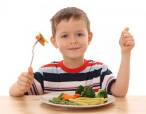 Kid eating veggies