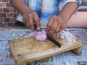 Man Chops Onions Faster Than A Blender