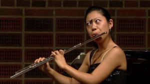 Butterfly Lands On Flutists Nose In Mid Performance