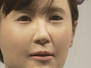Shoppers Greeted By Android Robot In Tokyo Mall