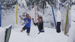 Nederland Residents Jump on Trampoline Buried Under Snow
