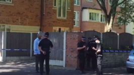 Police Cordon Off Block of Flats in South Manchester as Part of Investigation Into Arena Attack