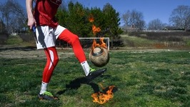 Soccer Player Shows Off Skill With Flaming Ball