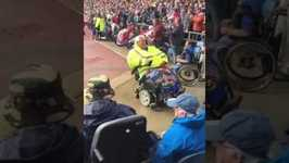 Soccer Fan in Motorized Wheelchair Celebrates Goal