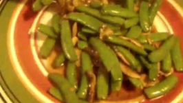 Stir Fry Sugar Peas And Mushroom Seasoning With Oyster Sauce And Sweet Black Sauce