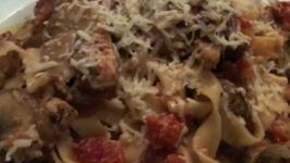 Bacon and Mushroom Fettuccine in Tomato Cream Sauce
