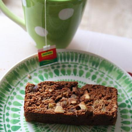 Slice of banana date bread on green plate