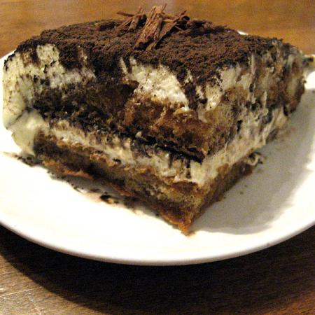 Tiramisù serving on a white plate