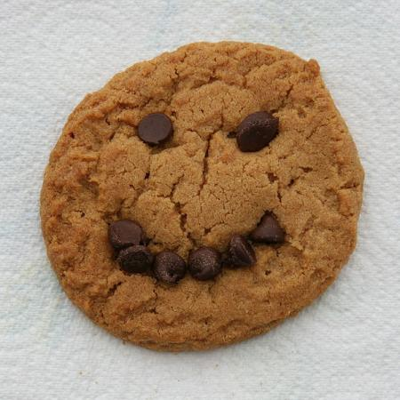 Peanut butter cookie with a chocolate chip smiley face