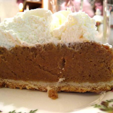 Pumpkin pie with whipped cream topping