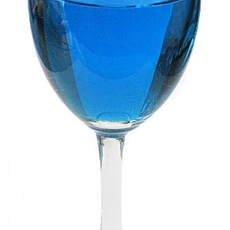 Wineglass with blue liquid