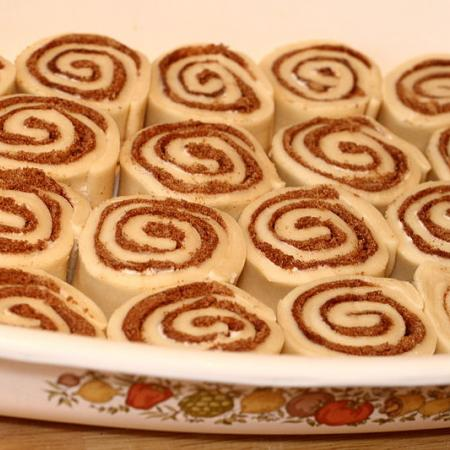 Uncooked cinnamon roll buns in pan