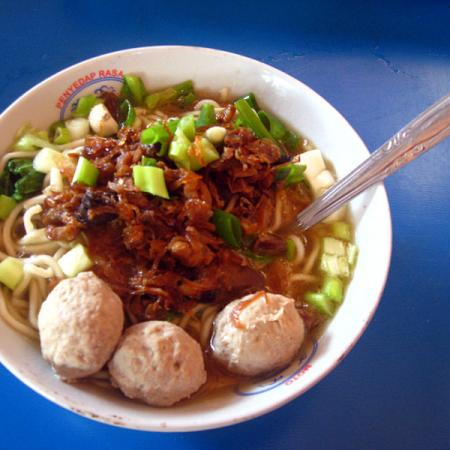 Bakso in bowl on blue table