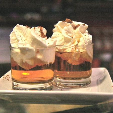 Shot of rum with cream and cinnamon covered