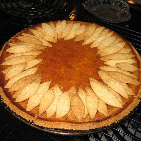 Pumpkin pie with pastry leaf decoration