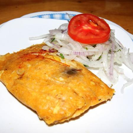 Tamal with salsa criolla
