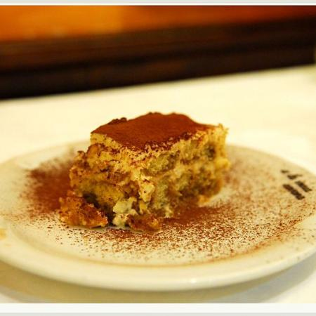 Tiramisu slice with cocoa powder