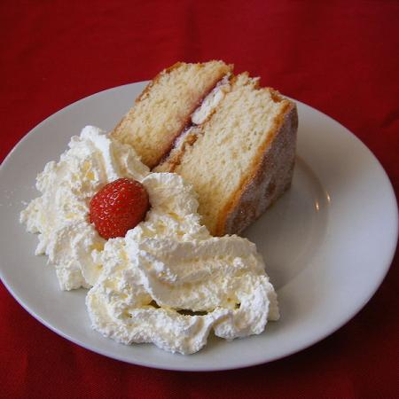 Sponge cake with cream and a strawberry