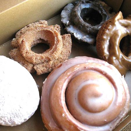 Variety of doughnuts with cinnamon roll