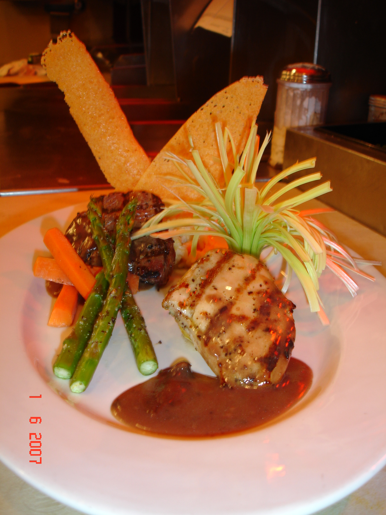 Filet Mignon And Grilled Chicken With Marsala Demi Glace picture