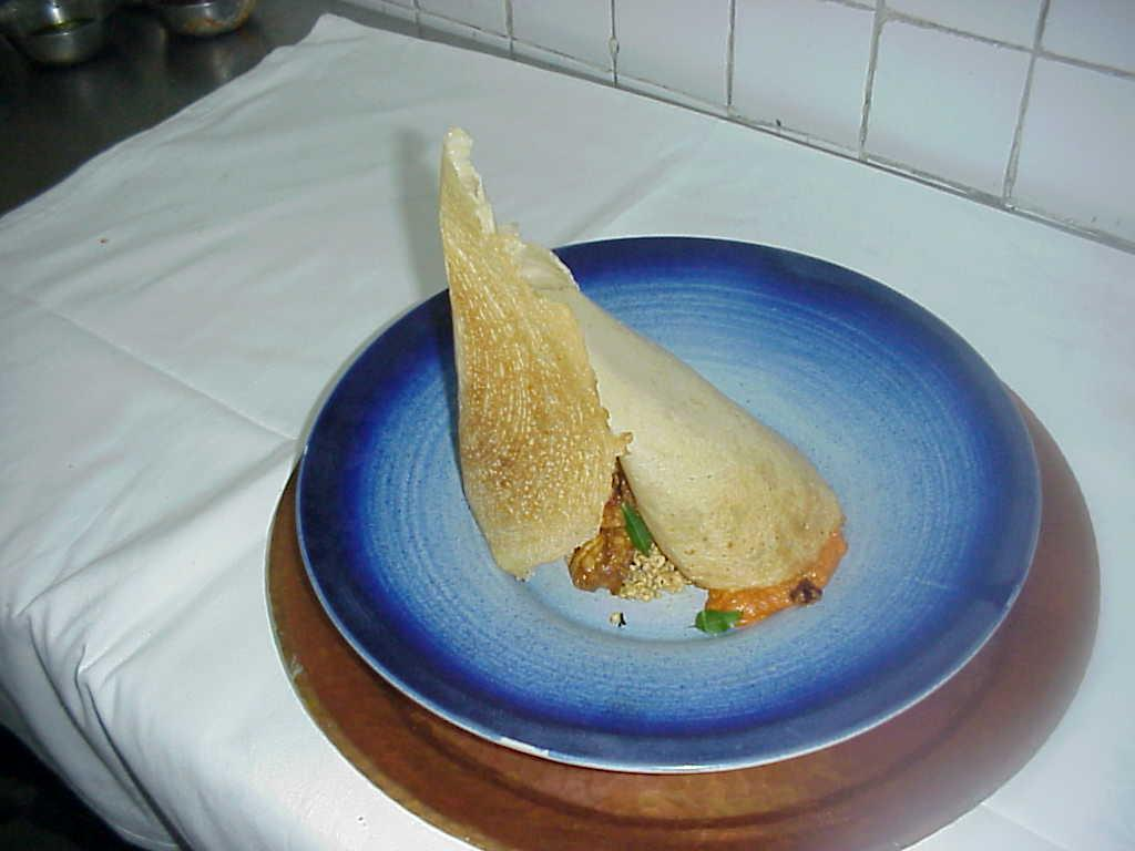 Dosa with a timbale of chicken mince picture
